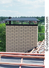 brick chimney on a house under construction - chimney with...