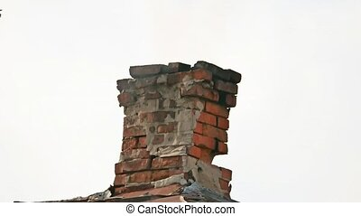 brick chimney smoke coming out of it on a white background sky