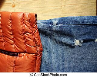 Brick Coloured Plastic Mac Jacket and Blue Jeans