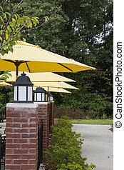 Brick Columns and Yellow Umbrellas
