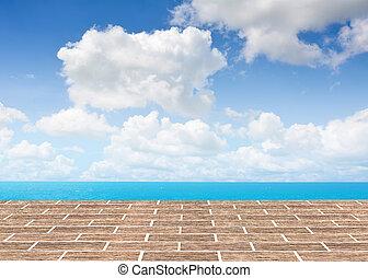 brick  floor with sea background.