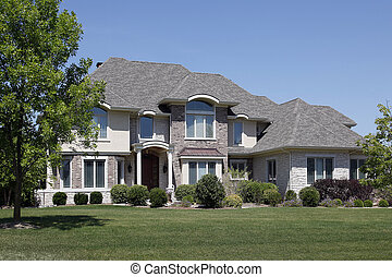 Brick home with arched entry and cedar roof