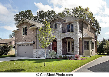 Brick home in suburbs with archway