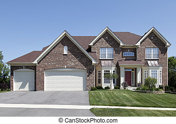 Brick home with covered entry - Brick home in suburbs with...