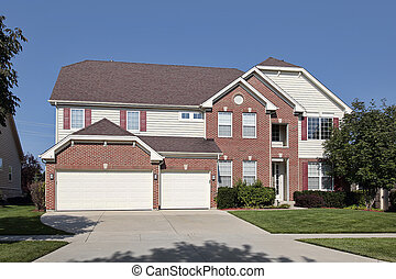 Brick home with three car garage