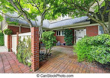 Brick house exterior with tile floor front yard