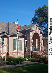 brick house with flag out front