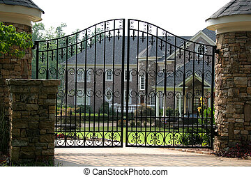 Brick Mansion - Brick mansion behind iron gate