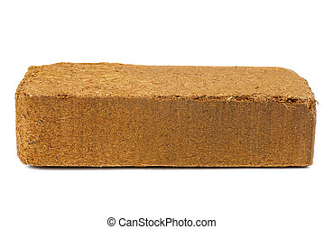 Brick of pressed coconut coir Isolated on white background