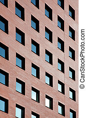brick office with many blue windows