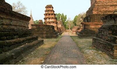 Brick pathway through ancient ruins