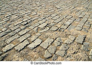 brick-paved ground