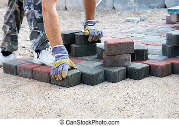 brick paver working on new street