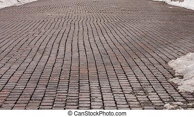 Brick Road - Old wet brick road in winter