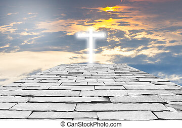 Brick road to a transparent cross giving out heavenly light on t