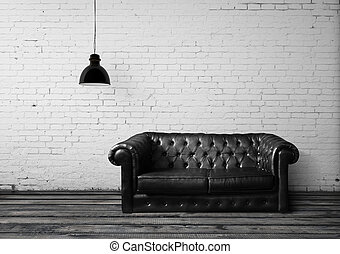 brick room with leather sofa