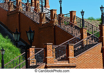 Brick stairs leading up to the lights