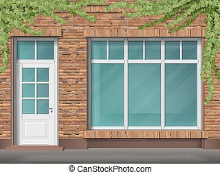 Brick store front with large window and ivy