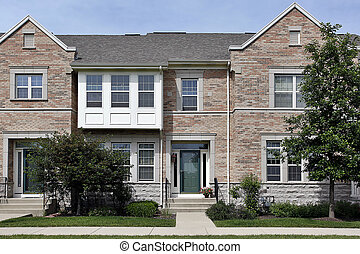 Brick townhouse in suburbs with cedar shake roof