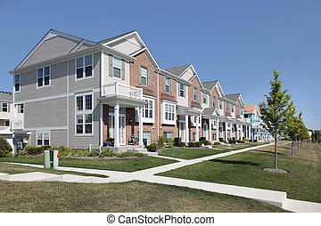Brick townhouses in suburban development - Brick townhouses...