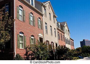 Brick Townhouses Under Blue Skies - A row of new brick...