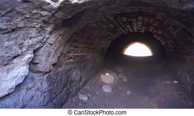 Brick Tunnel with Light at the End