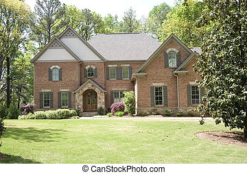Brick Two Story on Green Lawn