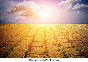 Brick walkway and sun light.