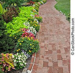 Brick Walkway in Garden - Winding red brick walkway in...