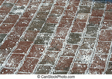 Brick walkway - A winter brick walkway covered with ice melt