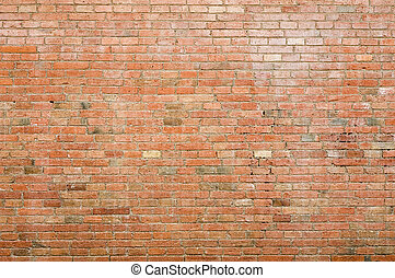 Brick wall - An old weathered brick wall; exposed brickwork
