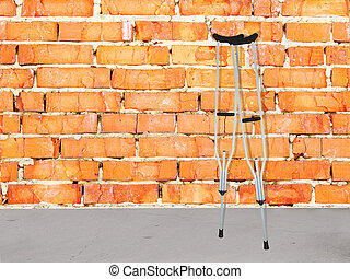 brick wall and and crutches - Background with the image of...