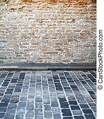 brick wall and cobblestone street