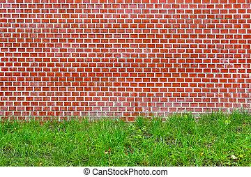 Brick wall and green grass