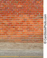 Red brick wall and sidewalk, vertical