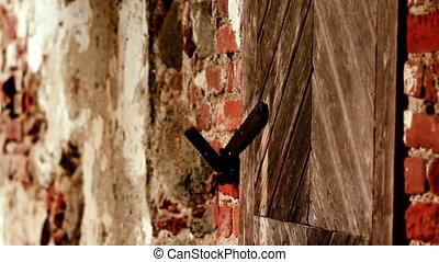 Brick wall and some wooden door