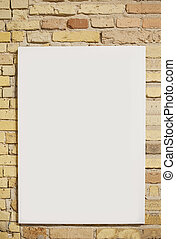 brick wall and white sheet with space for text