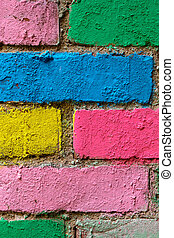 brick wall in different colors painted. Vertical.
