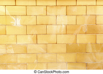 Brick wall in orange yellow tone