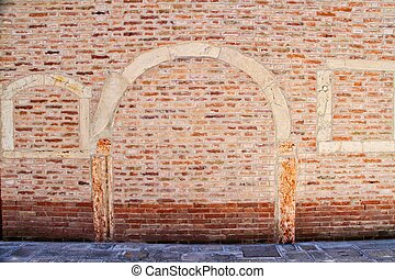 Brick Wall in Venice with Arch