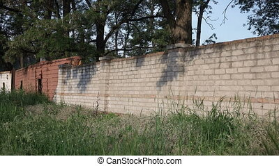 Brick wall industry - Light brick wall of old factory with...