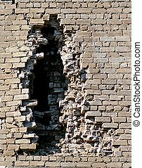 Brick wall of a building with an opening.
