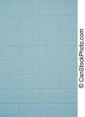 Brick wall painted with a blue paint