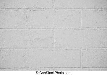 Brick wall painted with a white paint