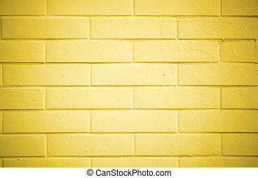 Brick wall painted with yellow paint