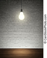 brick wall, table and lightbulb