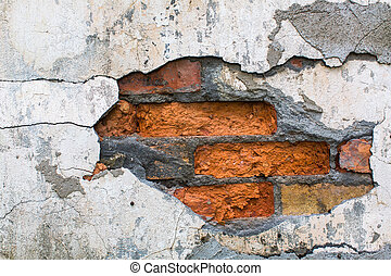 Brick wall texture with peeling paint.