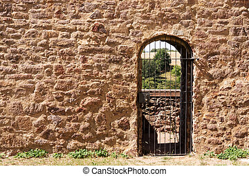 Brick wall with a barred door