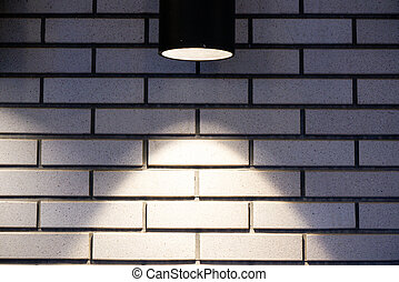 Brick wall with a lamp background