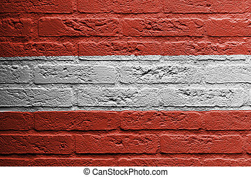 Brick wall with a painting of a flag, Austria